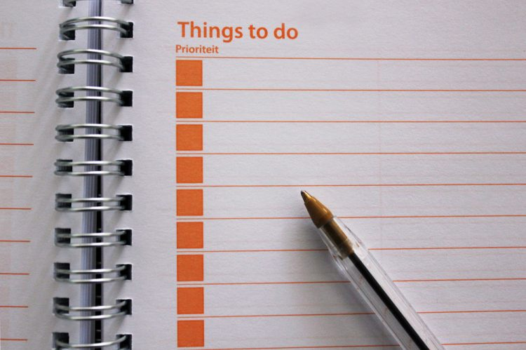 Things to Do notebook with a pen